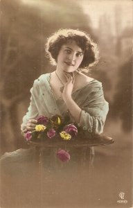 Pretty, sweet lady with roses Nice old vintage postcard