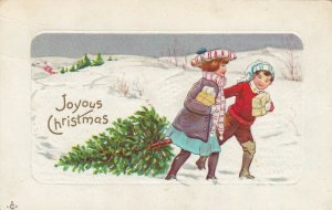 CHRISTMAS , 1900-10s ; Kids pulling a tree through snow