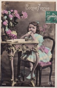 RP: NEW YEAR, 1910-20s; Bonne Annee, Little girl sitting at table sealing h...