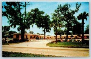 Biloxi MS~Flamingo Hotel Court~Pink Roadside Motel~Neon Art Deco Sign~1950s PC