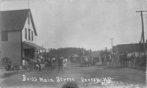 Benton N.B. D. W. Olts Store Busy Street View Horse & Wagons RPPC Postcard