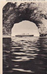 Steamship passing by the Arch in Perce Rock, Province Quebec, Canada, 10-20s