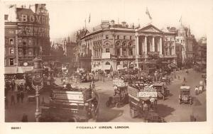 London, Piccadilly Circus, Advertising, auto, car trucks, buses, Bovril Schwepes