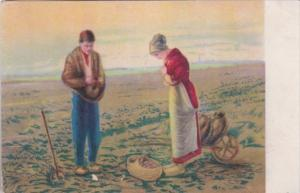 Couple In Potato Field Praying
