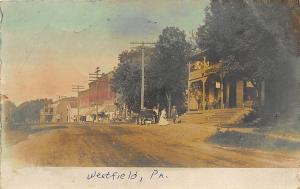 Westfield PA 1906 Dirt Street View Store Fronts Tinted RPPC Postcard