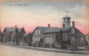 Amana IA Handcolored: Tower w/Belfry & Wind Vane Behind Home c1910