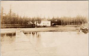 White Iron Lake MN Minnesota Dock Man Auto Co-Mo RPPC Real Photo Postcard D96
