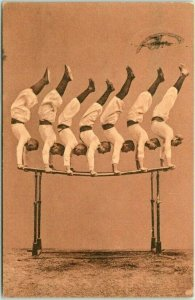 1908 German TURNERS Gymnastics Postcard 7 Men on Parallel Bars Dusseldorf Cancel