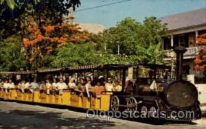 Conch Tour Train Along Poinciana Lined Street, Old Key West, FL USA Amusement...