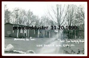 1090 - PETIT LAC MAGOG Quebec 1949 Manoir du Lac Cabins. Real Photo Postcard