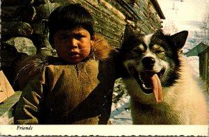 Alaska Eskimo Boy and Sled Dog
