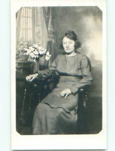 Pre-1930 rppc WOMAN WITH SHORT HAIR BY THE FLOWER VASE o2080