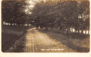 Poplar Lake Wisconsin~Dirt Road Drive~Thru Trees~Boat House on Shore~c1912 RPPC