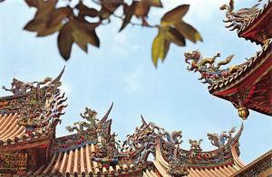 Taiwan The Lung Shan Temple The Flying Figures on the Roof Represent Dragons