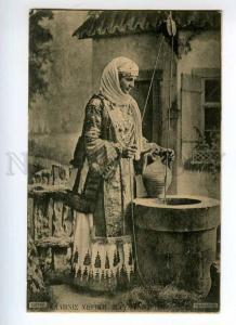 247714 GREECE girl in native dress WELL Vintage postcard