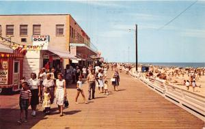 REHOBOTH BEACH DELAWARE~BOARDWALK & BEACH~OLD PRO GOLF~BRUEKMANN PHOTO POSTCARD