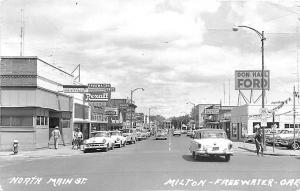Milton Freewater OR Don Hall Ford Dealership Main Street Old Cars RPPC Postcard