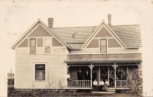 New Harmony Wisconsin~Ona Hoveland's House~Family on Porch~1909 RPPC