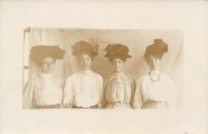 Real Photo Postcard~Four Victorian Teenage Girls in Fancy Hats~Bows~1908 RPPC