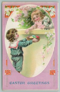Easter~Lil Blonde Girl Reaches Over Wall~White Bunny~Boy Offers Colored Eggs~Emb