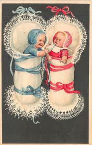 Girl & Boy Babies Feeding each other P.F.B. Published Embossed Postcard