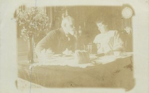 old Post card gentleman and lady serving dinner memory image