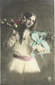 Beautiful girl holding a blue Sachel and Holly Branch in Colorized Sepia Gold