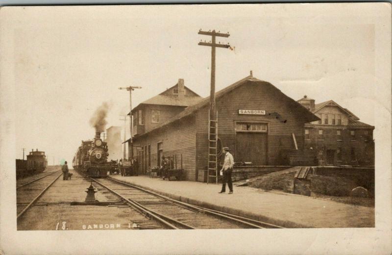 Sanborn Iowa~Railroad Depot~The Train We Start On to Ashton IL~1908 RPPC