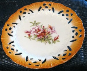 Decorative Plate with very pretty floral centre and pierced rim.  Approx 8.5 ins