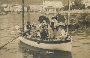 Social History Postcard Abbazia rowing boat elegant ladies fancy hats umbrellas