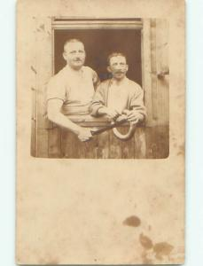 rppc 1920's MAN PUTS LARGE KNIFE INTO RING BEING HELD AC8520