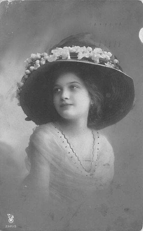Lady wearing Hat 1910 real photo, postal marking on front