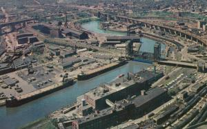 CLEVELAND , Ohio, 1950-60s ; Cuyahoga River lined with steel mills, Bridges