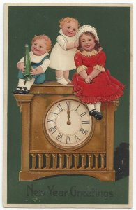 AS: NEW YEAR, PU-1908; Children sitting on top of clock, PFB 7954