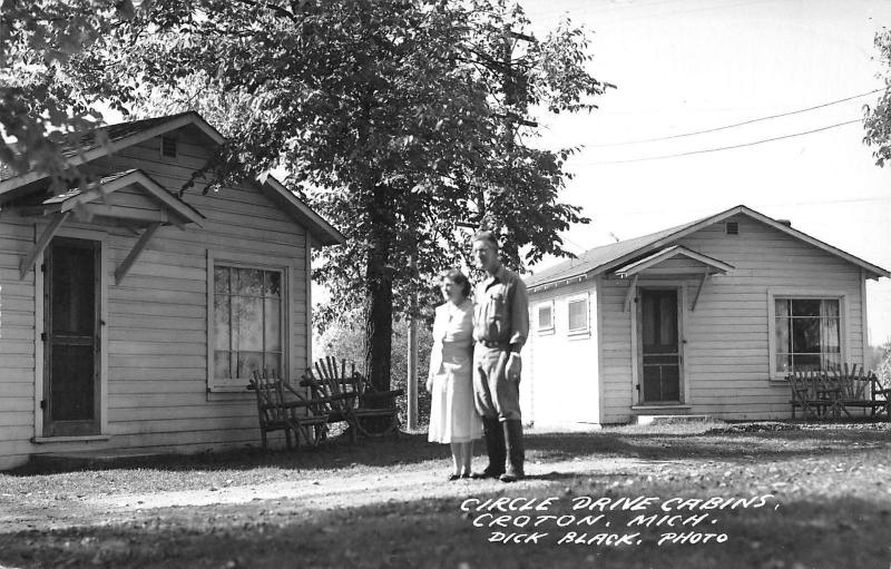 Croton Michigan~Older Couple by Circle Drive Cabins~Postcard RPPC c1950