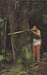 Cherokee Indian demostrating Blowgun Oconaluftee Indian Village North Carolina