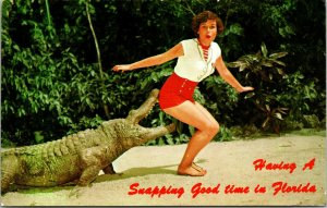 Postcard FL Humor Lady Alligator Having a Snapping Good Time Down In Florida