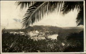 Philippines Village in Distance c1930 Real Photo Postcard - Used