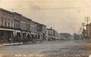 H9/ Stanton Michigan RPPC Postcard c1910 Main Street East Wagon Stores