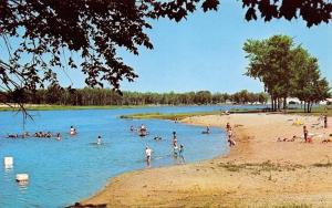 Clare Michigan~Lake Shamrock Beach Scene~Kids Wading~1960s Postcard