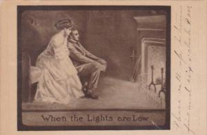 Romantic Couple Sitting By Fireplace When The Light Are Low 1910