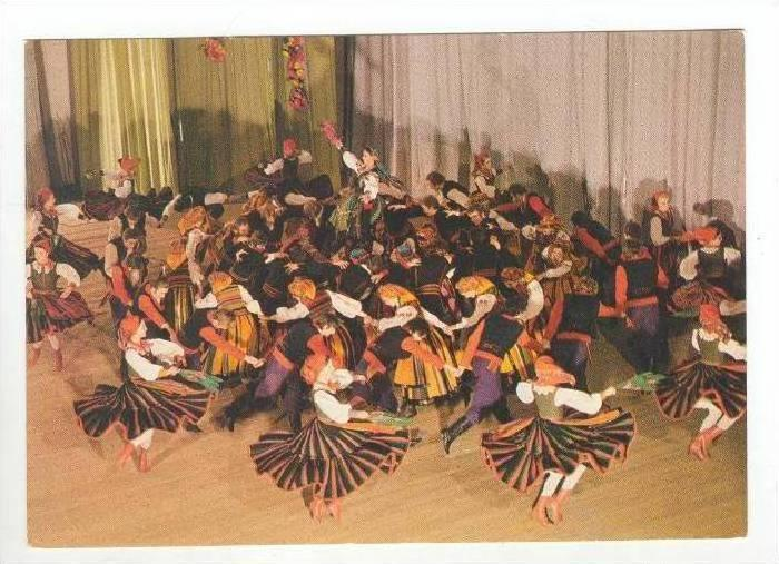 NATIVE FOLK DANCE = Crowd of Men and Women in Traditional Dress Dance the Maz...