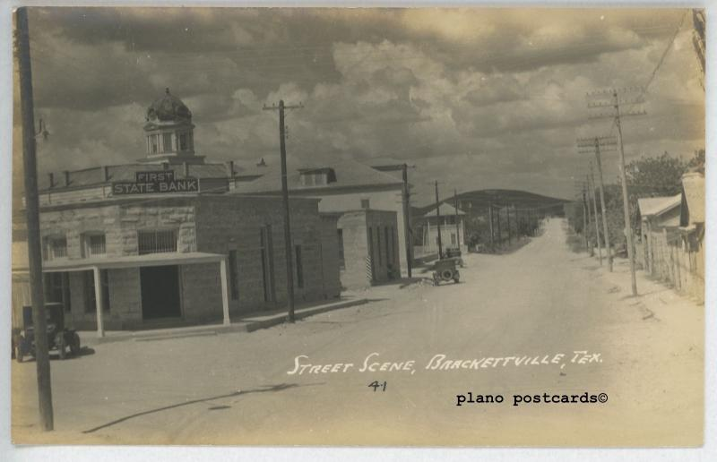 BRACKETTVILLE, TEXAS FIRST STATE BANK AND STREET SCENE RPPC POSTCARD