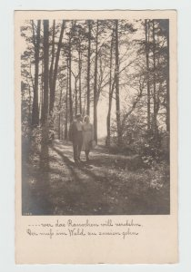 Vintage RPPC Postcard Meisteraufnahmen Nr 1446 couple walking in the woods 1937