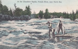 NORTH BAY , Ontario , Canada, 00-10s Men fishing at Chaudiere Rapids, French ...