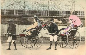 Hand Tinted Postcard Two Japanese Woman in Rickshaws Kimono and Parasol Geisha