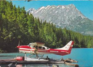Small Float Plane Rests on Chilko Lake, Scenic Mountain Background, Chilcotin...