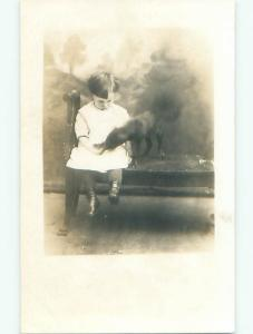 Pre-1920's rppc BLURRY DOG EATING FROM CHILD'S HAND o2286