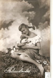 Pretty lady with rabbits in the field Nice vintage Spanish postcard