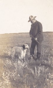 RP: Hunter posing with rifle & Dog in field , 1901-07